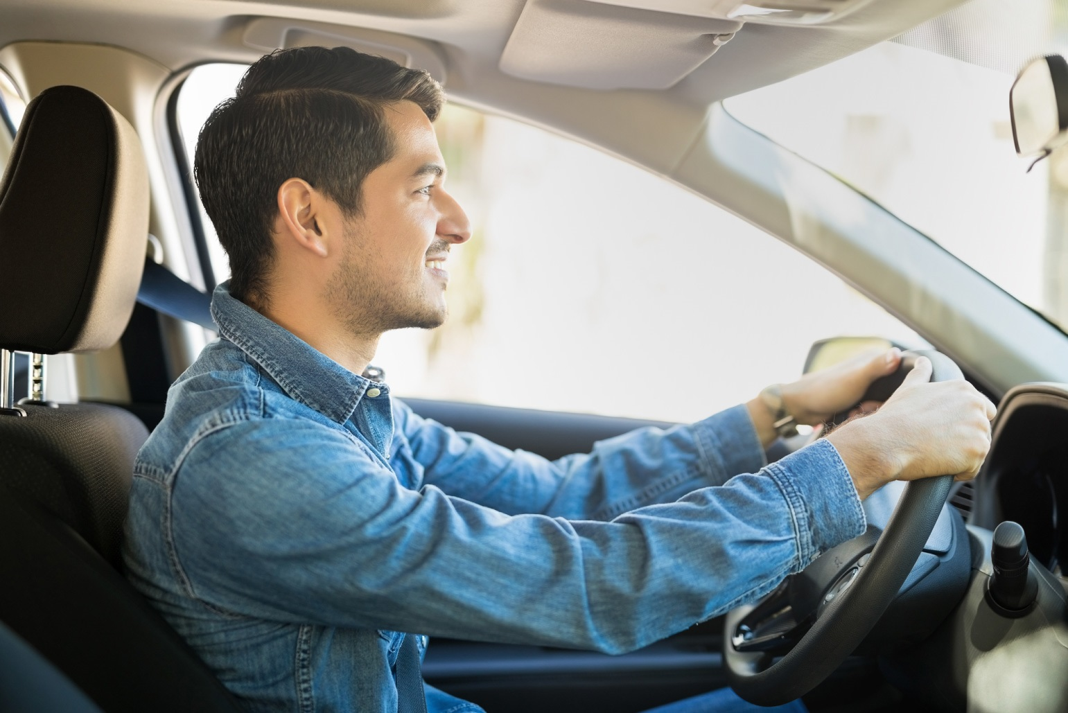 Man driving car with credit acceptance auto loan