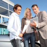 What is a new vehicle's dealer invoice price?