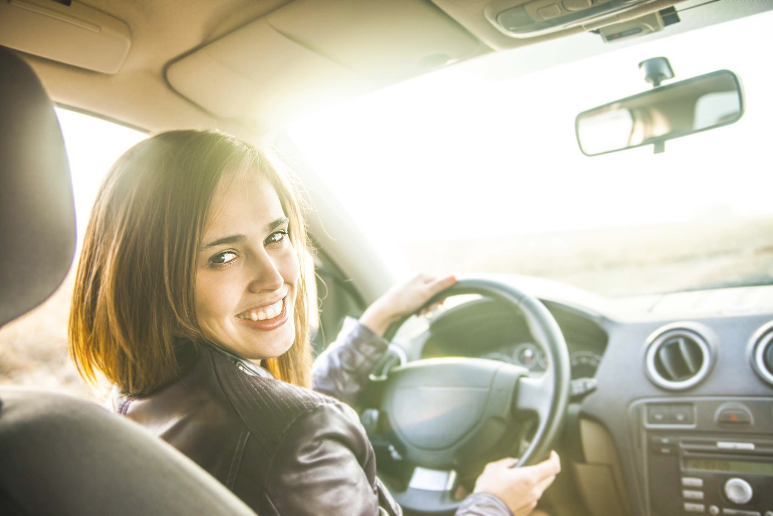 Woman in car purchased with auto loan