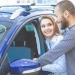 Man and woman co-borrowers looking into new car
