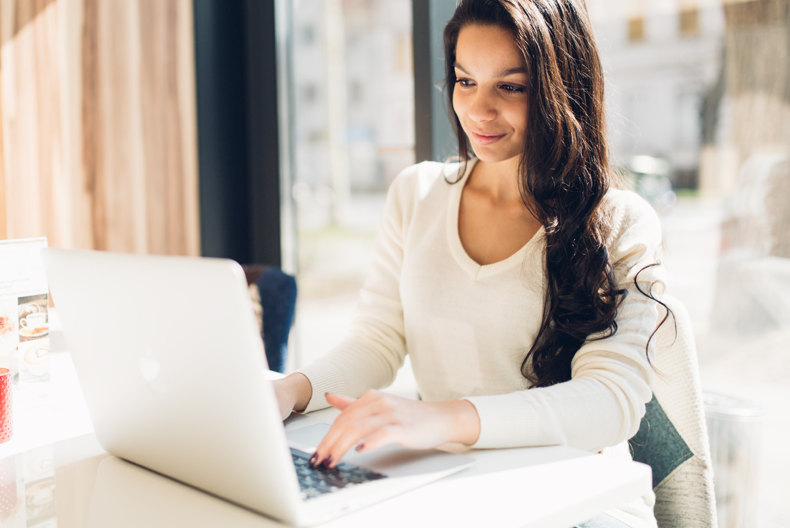 Woman using laptop for auto loan approval