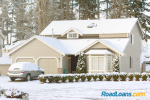 Snow-covered car and home