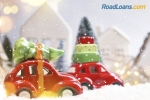 Cars driving toward happy holidays