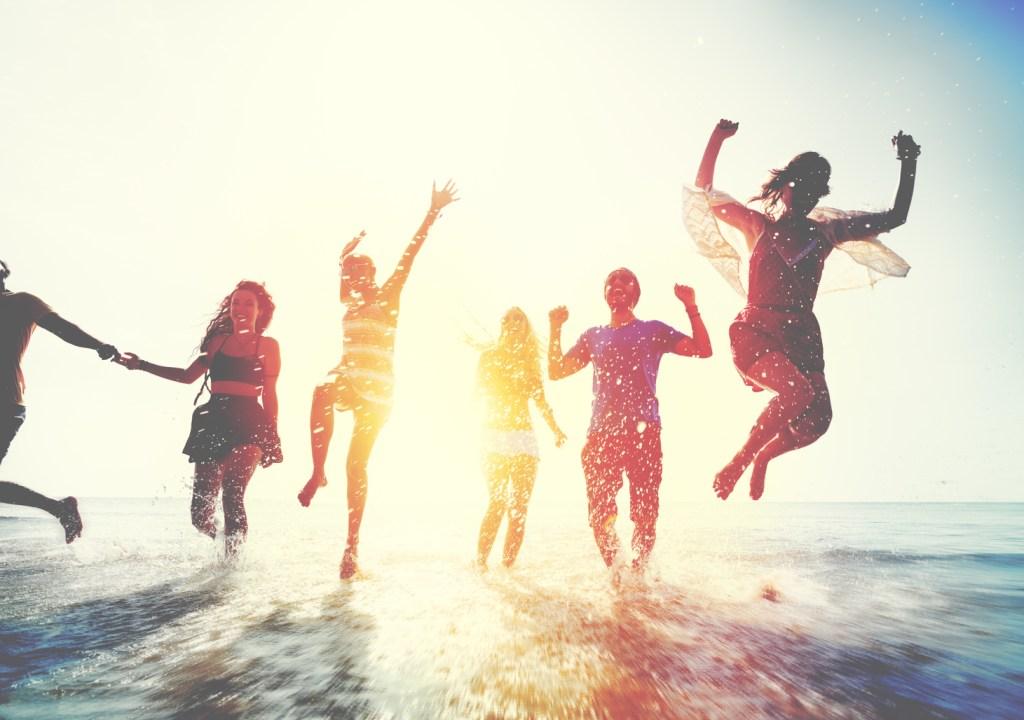Students on spring break on seashore