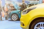 Car shoppers and cars at auto show