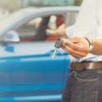 Man holding car keys on a vehicle trade-in