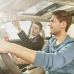 Car dealer and car buyer sitting in car