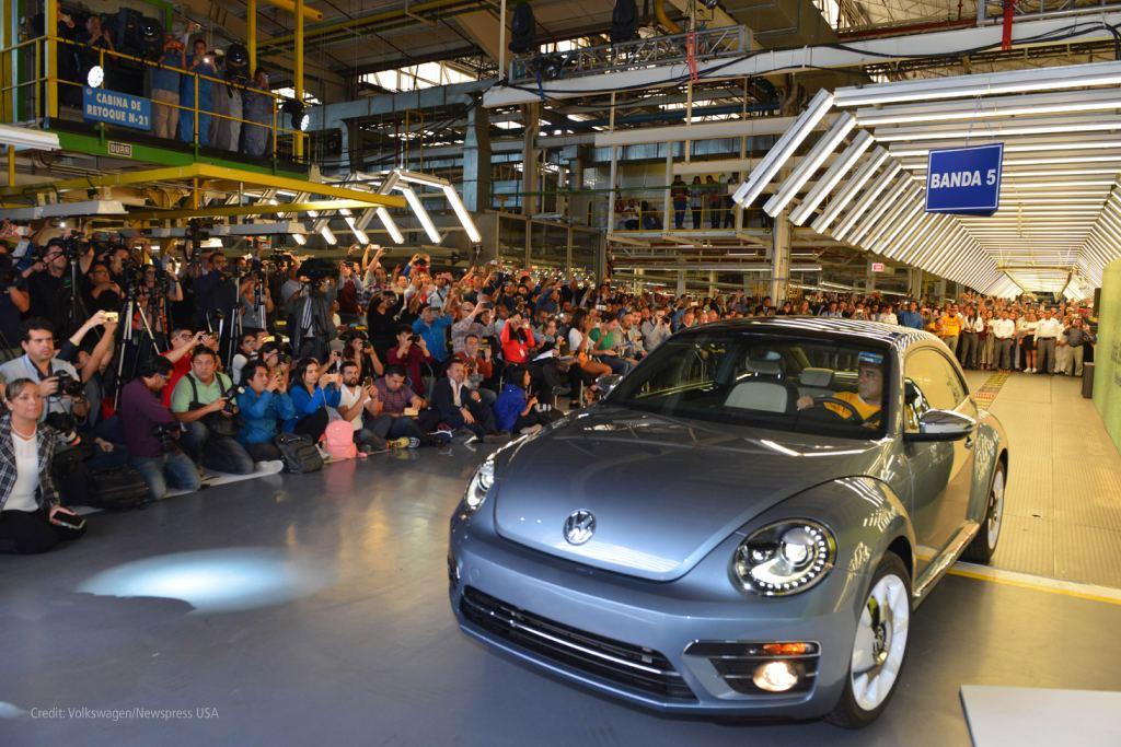 Beetle car drives across factory floor