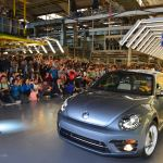 Beetle car drives across factory floor