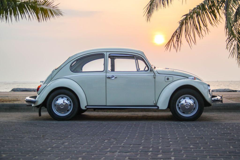 Vintage VW Beetle next to ocean