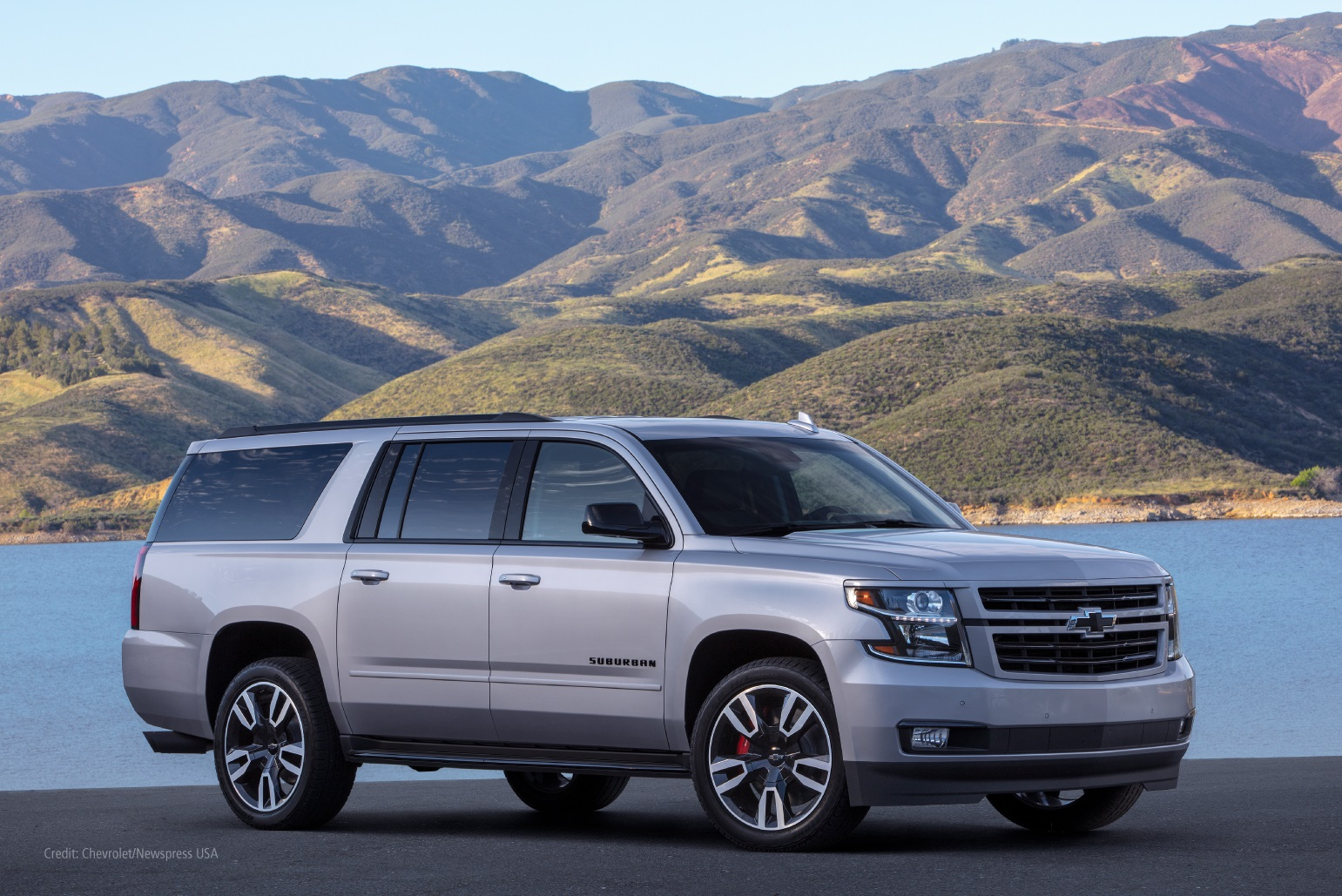 Chevrolet Suburban in front of mountains