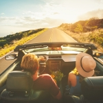 Couple in convertible car purchased with finance